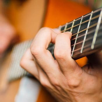 How Hard Should You Hold Down Guitar Strings?