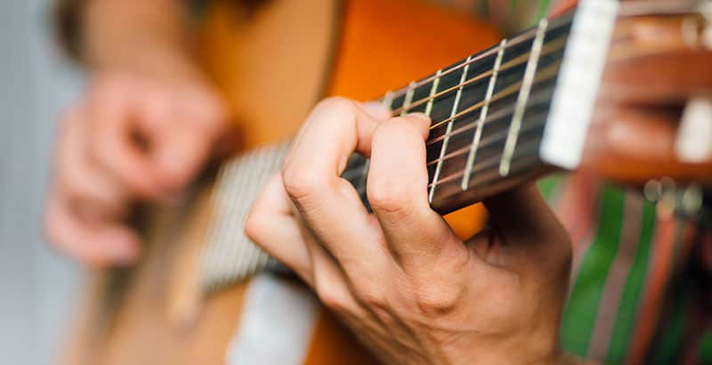 How Hard Should You Hold Down Guitar Strings